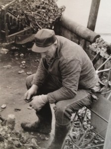 An oysterman resting from sorting oysters